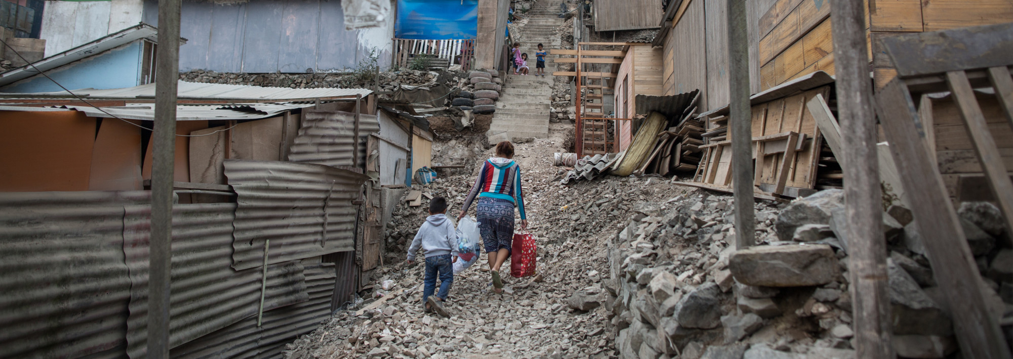 Woman and a child walking through an alleyway