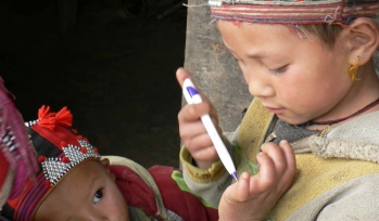 Two boys playing with pens