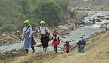 Children walking along a river
