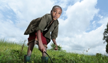 Child working in a field