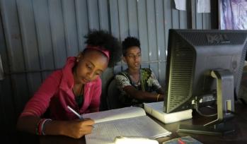 School children working at a computer