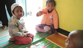 Children sat on the floor at school