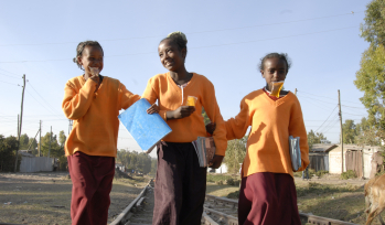 Three children walk to school