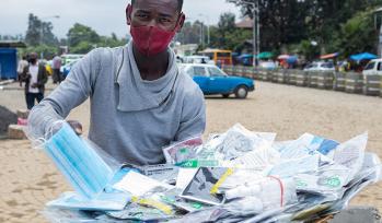 Boy selling face masks