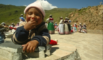 Child in front of a group and hillside