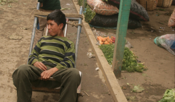 Boy sat in a market