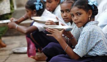 Girls eating food outside