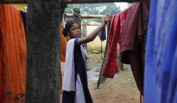 Woman hanging out washing