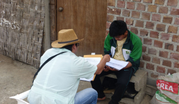 Fieldworker running a survey