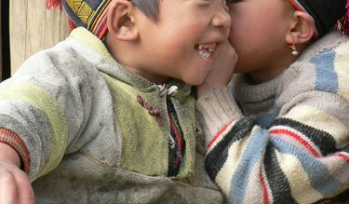 Two children whispering and playing