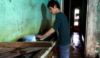 Young man doing carpentry