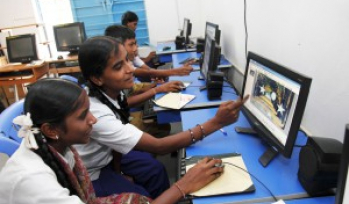 School children working on a computer