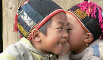 Two boys whispering together