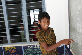 India, school boy in the classroom