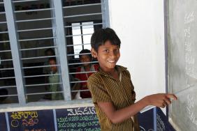 India, school boy in the classroom