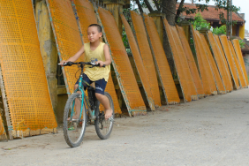Vietnam - boy on bike