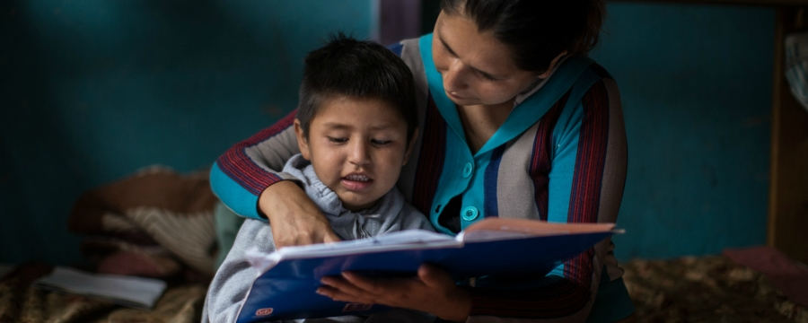 mother and child reading Peru