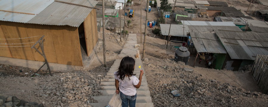 Girl walking down a staircase in her village