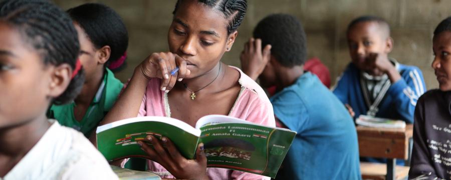 School girl reading a text book