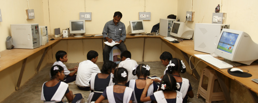 Teacher and students in an IT classroom