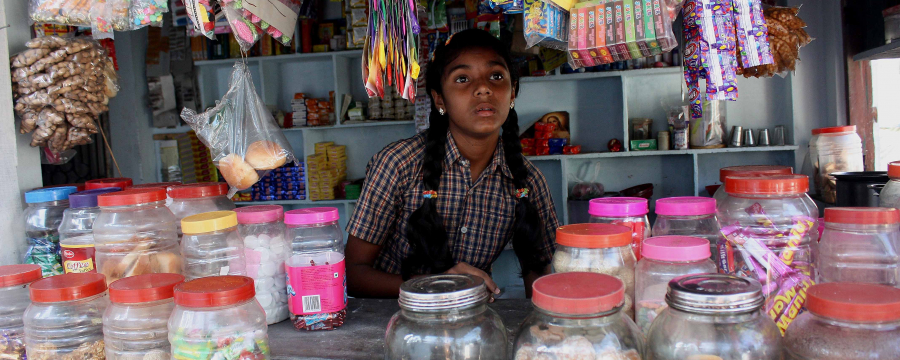 Girl working on a sweet stall