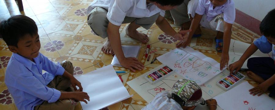 Children drawing on the floor