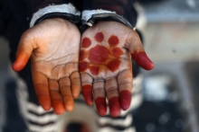 Child's hand with a flower painted on it