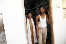 Man and woman stood in a doorway
