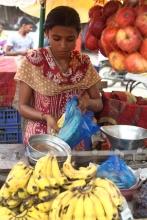 Woman buying bananas at a market