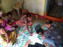 Teacher and students working on the floor
