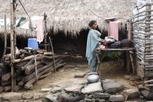 Working outside a hut