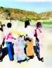 Five girls walking down a road