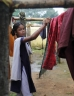 Young woman hanging out washing
