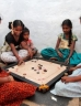 Girls playing a board game