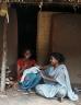 Two women sat outside