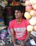 Boy working in a market stall