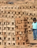 Young boy stood in a brickyard