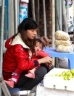 Mother and child selling fruit at a street stall