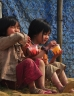 Children eating sweets outside