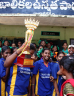Sports team hold up the winners cup