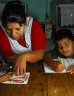 Mother helping children with their homework