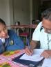 Researcher interviewing a school child