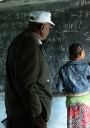 Image_ET_413A1854_girl with teacher at blackboard