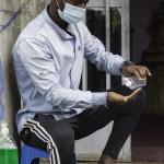 Ethiopian Man using sanitiser
