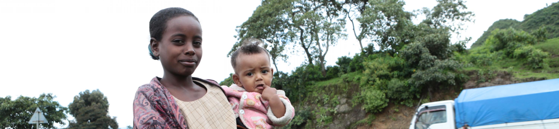 child holding baby